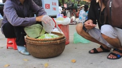 Woman selling fried rice in the market,Asia - stock footage