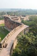 agra fort with taj mahal in the background - stock photo
