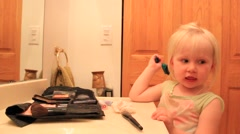Two year old smooths down her bangs Stock Footage