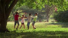 16of18 Children playing, dancing, young people, summer fun, friends, group - stock footage