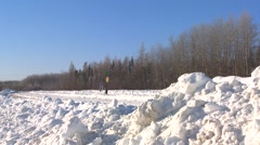 Stock Video Footage of A VIA rail Canada passenger train passes in the snow.