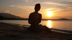 Woman in Bikini Enjoying Sunset at Beach with Pet Dog. Slow Motion. Stock Footage
