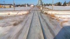POV from the front of a train passing through a snowy landscape. Stock Footage