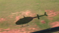 Helicopter shadow as it lands Stock Footage