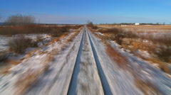 Time lapse POV from the front of a train passing through a snowy landscape. Stock Footage