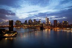New york city manhattan downtown with brooklyn bridge at dusk Stock Photos