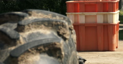 Close up of tractor's tyre with crates behind Stock Footage