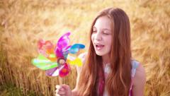 Young Girl Playing With Pinwheel - stock footage