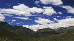 Cinematic time lapse of mountain valley with beautiful clouds changing shapes Stock Footage
