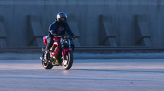 A rider performs amazing stunts on a motorcycle. Stock Footage