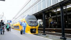 Train arriving to the Haarlem railway station in Haarlem,Netherlands, Stock Footage