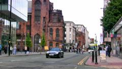 Deansgate in Manchester with light traffic and passers by Stock Footage