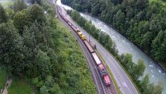 Aerial view of the Alps in Austria, mountains, river and railroad Stock Footage