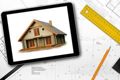 digital tablet, tools and architect draft on the table - stock photo