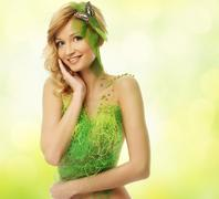 beautiful young woman in conceptual spring costume with butterfly - stock photo