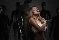 young woman in bandage among mannequins - a plastic surgery concept - stock photo