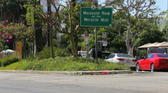 Miracle Mile Museum Row Sign with Cars Passing - stock footage