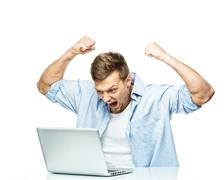 Angry stylish young man behind laptop Stock Photos