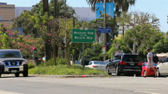 Museum Row Miracle Mile Sign With Traffic in Los Angeles Stock Footage