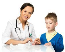 little boy visiting paediatrician office - stock photo