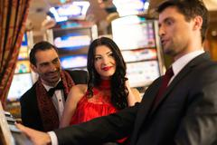 young people near slot machine in a casino - stock photo