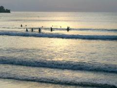 People swimming in the sea at sunset, slow motion shot at 240fps - stock footage