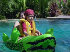 Mother playing with son in the swimming pool, slow motion shot at 240fps Stock Footage