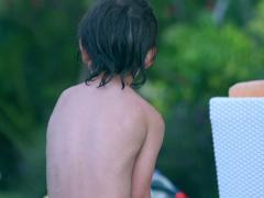 Happy boy playing in the pool, slow motion shot at 240fps Stock Footage