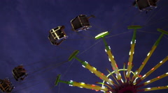 The Swing Ride at the County Fair at 240 fps Stock Footage