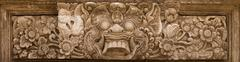 horrible mythical monster face. stone relief from indonesia, bali island - stock photo