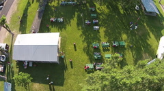 Aerial rural town park festival descending HD 020 Stock Footage