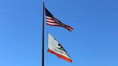 California Flag and American Flag Flies Against Blue Sky Stock Footage