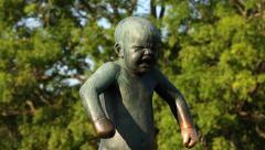 Grumpy Boy Sinnataggen Vigeland Sculpture Park Oslo motorized slider shot Stock Footage