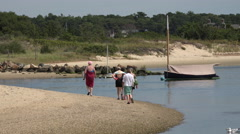 Cape cod people walking on the beach Stock Footage