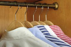 shirt hanging behind - stock photo