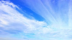 Time lapse of white clouds with blue sky Stock Footage
