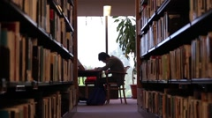 Male Student Studying in Library - Wide Stock Footage