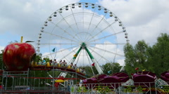 Ferris wheel and rides in the amusement park Stock Footage