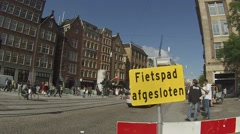 "Cyclists pass a ""closed cyclepath"" sign, Amsterdam Stock Footage"