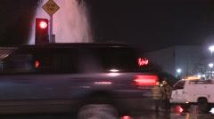 Firemen try to shut of a broken water main in Los Angeles. Stock Footage