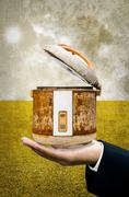 Stock Photo of time to change your rice cooker concept, old rice cooker in businessman hand