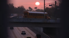Sunset over a freeway on a hazy smoggy day in Los Angeles. - stock footage