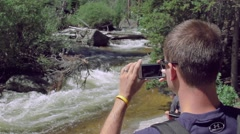 Hiker Takes Photo on iphone of Stream in Colorado  Stock Footage
