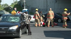 4K UHD - Pedestrian struck laying on ground near taxi with broken windshield Stock Footage