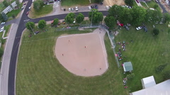 Aerial softball game rural community park HD 011 Stock Footage