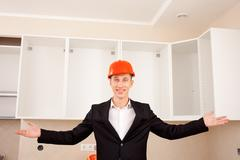 smiling civil engineer shows new apartment - stock photo