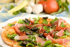 pizza with ham, olives and capsicum pepper - stock photo