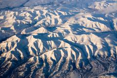 Aerial view of frozen mountains in the north pole Stock Photos