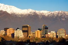 Skyline of providencia district in santiago de chile with snowed andes mounta Stock Photos