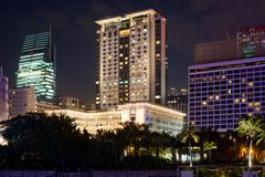 The peninsula and sheraton luxury hotels on the kowloon waterfront, tsimshats Stock Photos